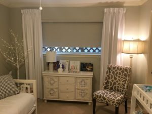 nursery with roller shades and curtains