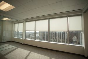 elegant roller shades in windows of Dallas office building