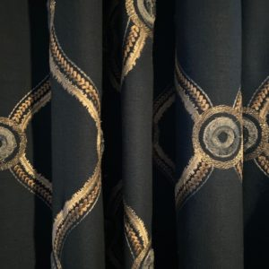 close-up of dark custom drapery with gold pattern