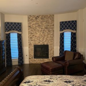 bedroom with beautiful printed custom window treatments in Dallas