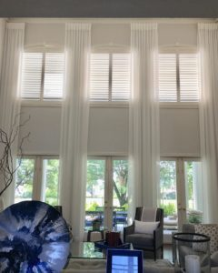 Beautiful, well-designed living room with custom window treatments
