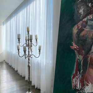 Lovely sheer custom curtains in Dallas next to artwork