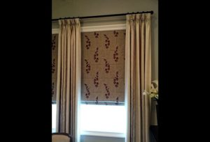 Layered window treatments in Dallas — Roman shades and curtains
